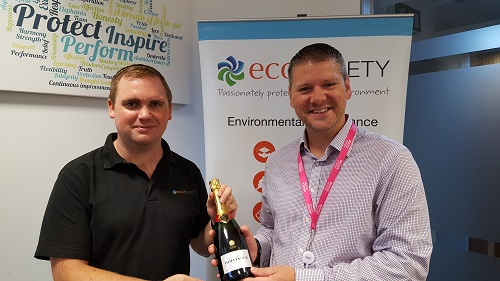 competition winner James Piper form Ecosurety receiving champagne
